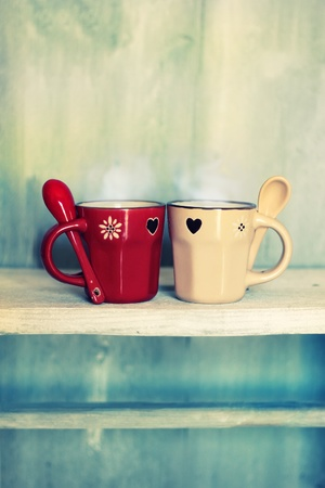 Retro photo of two cute coffee cups photo