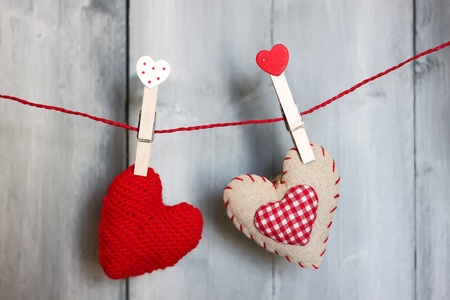 Photo of fabric heart on wooden background photo