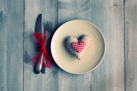 St Valentine's day greeting card with plate, knife, fork and heart photo