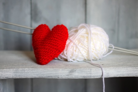 balls of yarn: Photo of ball of wool and heart on wooden background