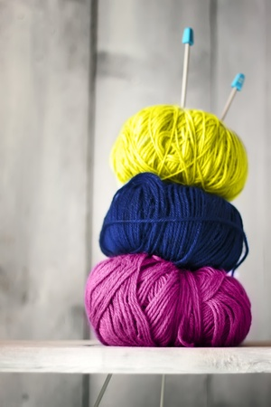 clew: Photo of blue, purple and yellow balls of wool Stock Photo