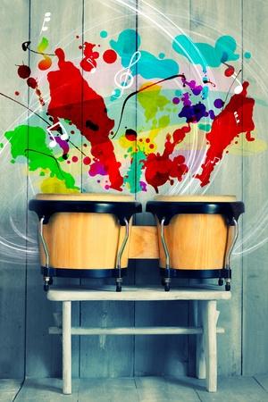 bongo drum: Photo of bongo drums with wooden background
