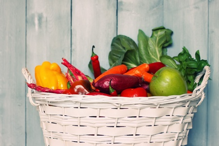 colorful still life: Photo of white basket with vegetables Stock Photo