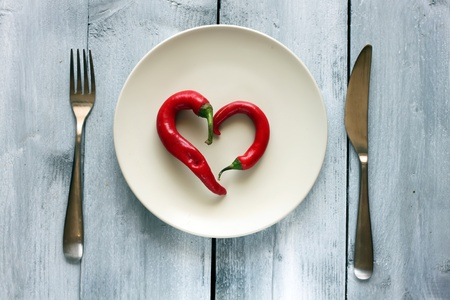 St Valentines day greeting card with plate, knife, fork and heart photo