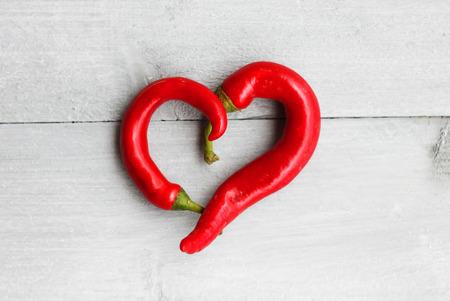red heart shape chili pepper photo