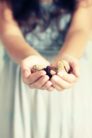 Photo of girl holding nuts photo