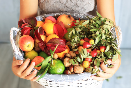 Photo of girl holding basket with fruits photo