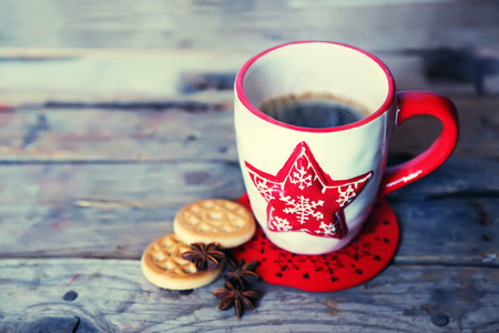 Retro photo of cute coffee mug with cookies photo