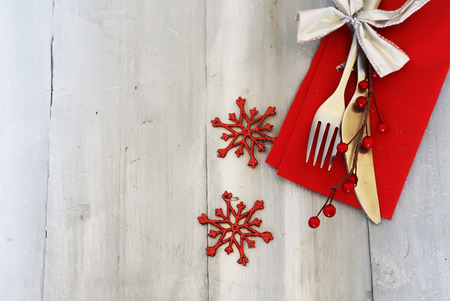 christmas dish: Christmas day greeting card with plate, knife and fork Stock Photo