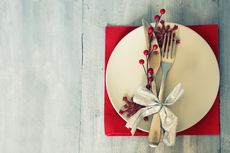 christmas catering: Christmas day greeting card with plate, knife and fork Stock Photo
