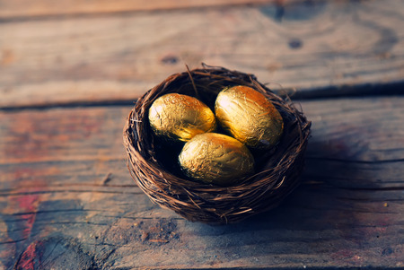 Cute retro photo with gold easter eggs photo
