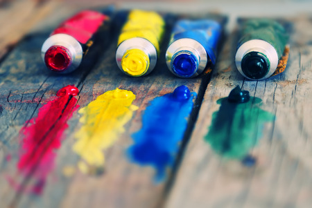 tempera:  4 paint tubes: red, yellow, blue and green Stock Photo