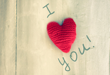 Photo of wool heart on wooden background photo