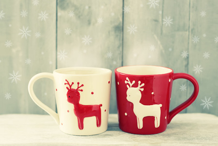 cup of coffee: Retro photo of two cute coffee cups Stock Photo