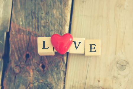 wooden block: Photo of wooden block with word LOVE Stock Photo