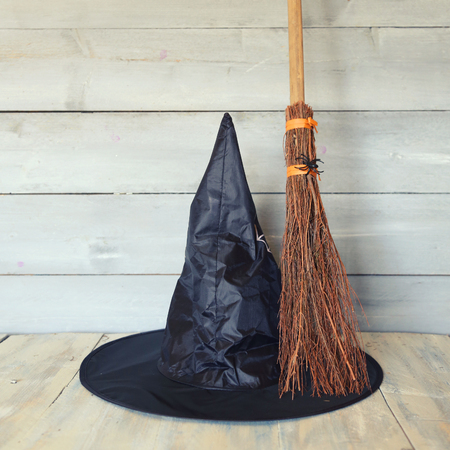 Halloween photo with witch hat and broom Stock Photo