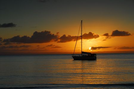 moored: Small yacht moored at sunset Stock Photo