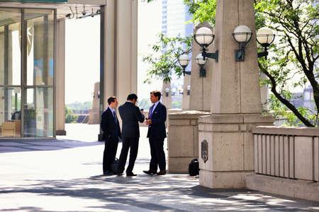 diplomatic: Diplomatic office building on three men