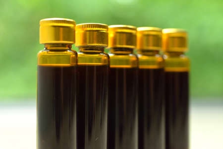 formulations: Chinese traditional medicine oral liquid in small glass bottles