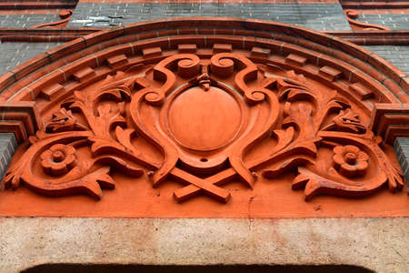 concession: Carved door arches on bricks wall Stock Photo