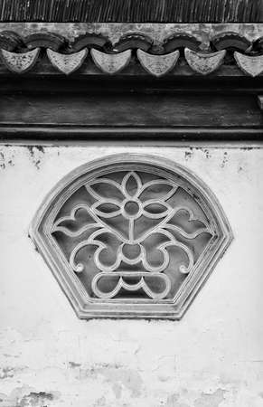 fan shaped: ancient chinese style of fan shaped window Stock Photo