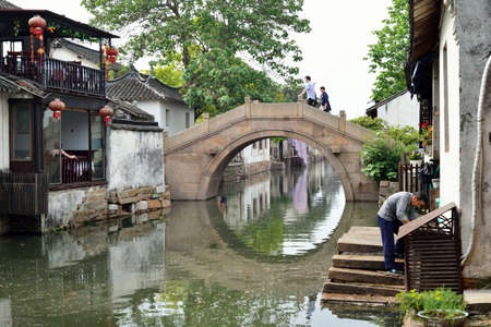 architecture bungalow: Stone arch bridge in the south of China