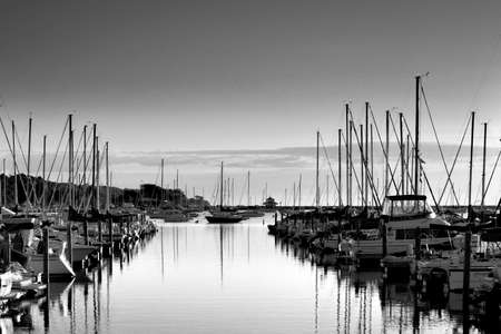 Black and white photo of yacht dock Editorial