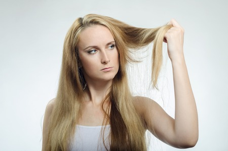 20 29 years: Girl looks at the tips of the cross-section of hair