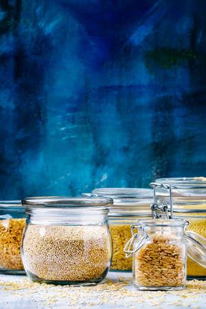 Assorted cereals in glass jars: kinoa, bulgur, couscous, orzo, brown rice, selective focus Stok Fotoğraf