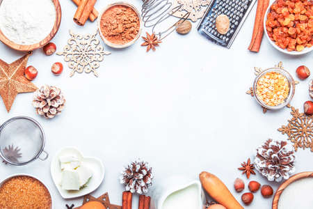 Christmas or New Year composition with ingredients for baking festive cookies, with golden snowflakes, Christmas balls, pine cones on white background, top view Imagens
