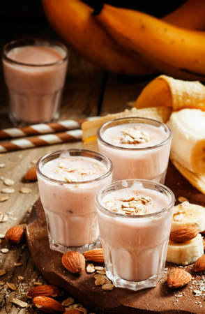 Smoothie with banana, yogurt, oatmeal and nuts, selective focus Archivio Fotografico