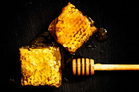 Bee honeycomb, dark background, top view Reklamní fotografie