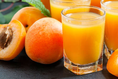 Freshly squeezed apricot juice, selective focus