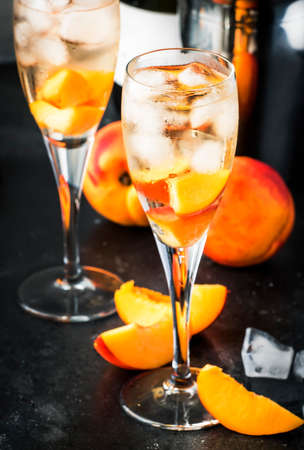 Bellini, alcoholic cocktail with sparkling wine, sugar syrup, lemon juice, peach and ice, gray table background, copy space Reklamní fotografie - 151099799