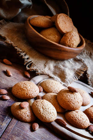 Homemade cookies with nuts, dark wood background, selective focus