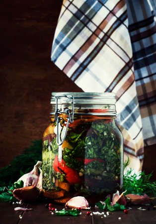 Marinated eggplant with onions and peppers in a bowl, vintage wooden background, selective focus Reklamní fotografie
