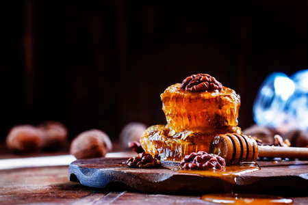 Honey with walnuts, vintage wooden background, selective focus Reklamní fotografie