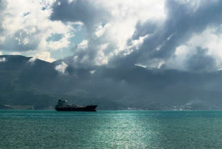 Cargo ship in the Black Sea, sea landscape on a background of mountains