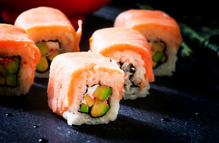 Rolls with avocado and salmon, selective focus