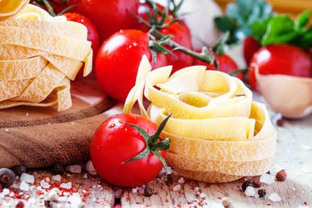 Tagliatelle and tomatoes, horizontal image, selective focus Stock Photo