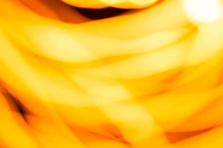 Blurred moving fire lights background, yellow, orange and white colors on black, abstract template for design, high resolution