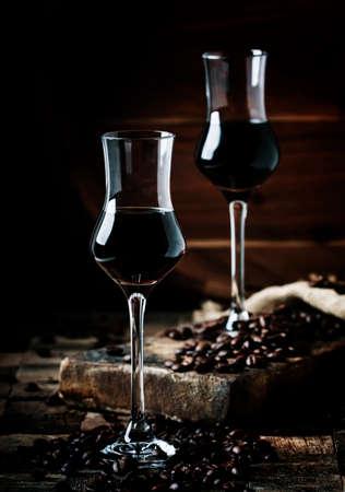 Coffee liqueur, vintage wooden background, selective focus