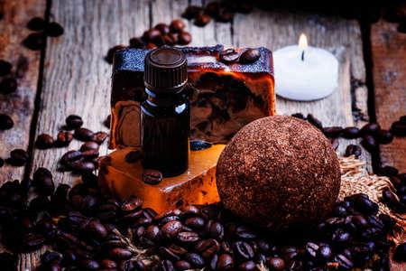 Coffee spa: soap, oil, salt, candles. Vintage wood background, selective focus