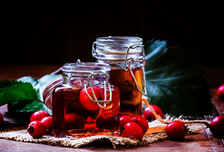 Alcohol tincture of hawthorn berries, vintage toned photo, selective focus