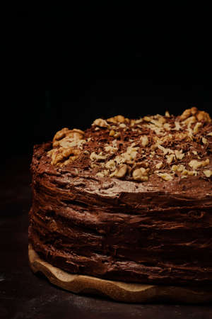 Homemade chocolate cake with nuts, black background, selective focus 스톡 콘텐츠