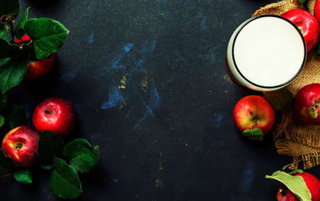 Apple cider in glass, black background, top view Stock Photo