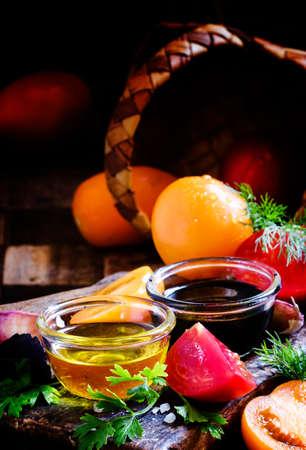 Ingredients for the preparation summer salad: tomatoes, parsley, basil, oil, vinegar, salt, selective focus