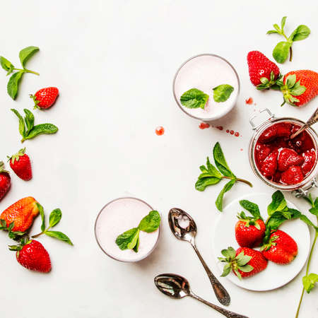 Strawberry milkshake with mint, white background, top view