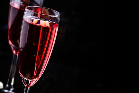 Red sparkling wine, black background, selective focus