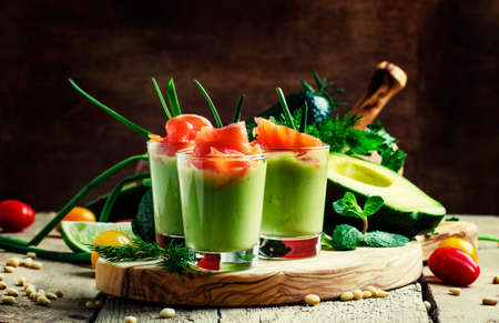 Appetizer with smoked salmon and avocado mousse, served in glasses, vintage wooden background, selective focus Banque d'images